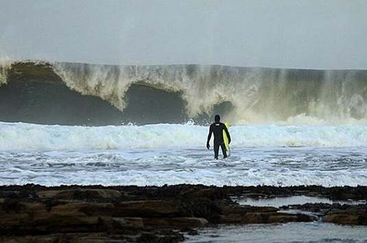 paddling-out-mid-winter-alex-sutherland-luna-surf-wetsuit.png